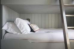 One of the bedrooms is a smart, light filled, tongue and groove ships cabin with two built in bunks